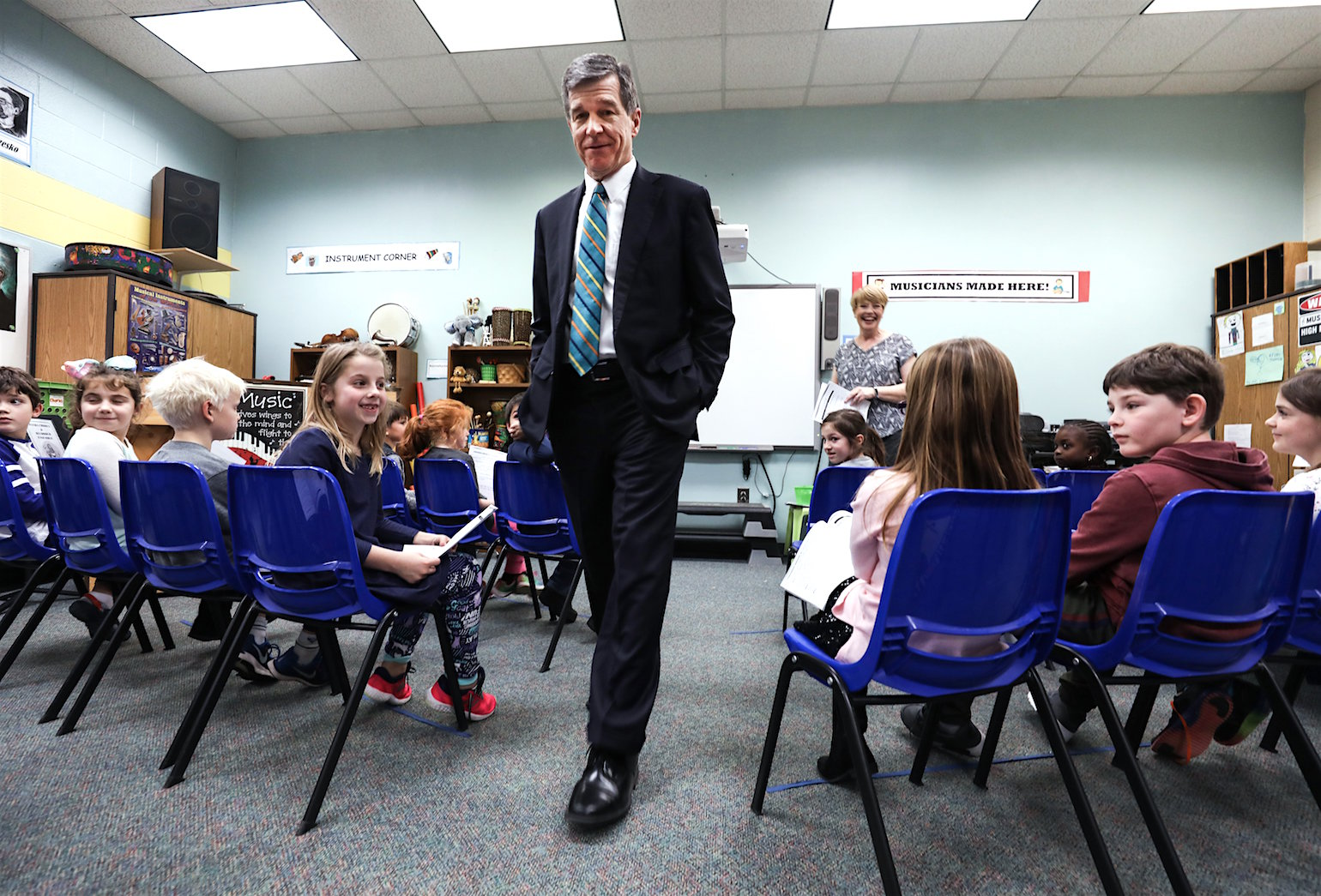 Governor Roy Cooper leaves a music classroom, which could be lost as an educational space if the class-size mandate remains unfunded. Gov. Cooper spoke with students at Penny Road Elementary School on Tuesday January 9, 2017.