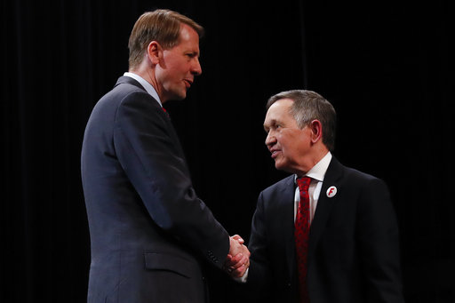 Richard Cordray, former federal consumer protection chief, left, and former U.S. Rep. Dennis Kucinich, right, shake hands after the Ohio Democratic Party debate in the primary race for governor,  April 10, 2018, at Miami (Ohio) University. (AP)