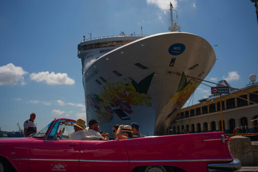 Tourists who have just disembarked from a cruise liner, tour the city aboard a vintage American convertible, in Havana, Cuba, Tuesday, June 4, 2019. The Trump administration has imposed major new travel restrictions on visits to Cuba by U.S. citizens. (AP