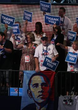 "Delegates hold up ""Thank You"" signs during day three of DNC in Charlotte on Thursday. President Obama's nomination acceptance speech was aimed at convincing voters that a slow economic recovery will accelerate if they give him a second term."