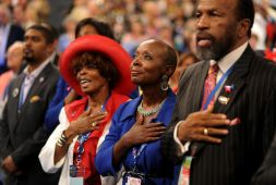 Delegates recite the Pledge of Allegiance during day two of the DNC in Charlotte on Wednesday. President Barack Obama's nomination acceptance speech has been moved indoors tonight because of the possibility of severe weather.