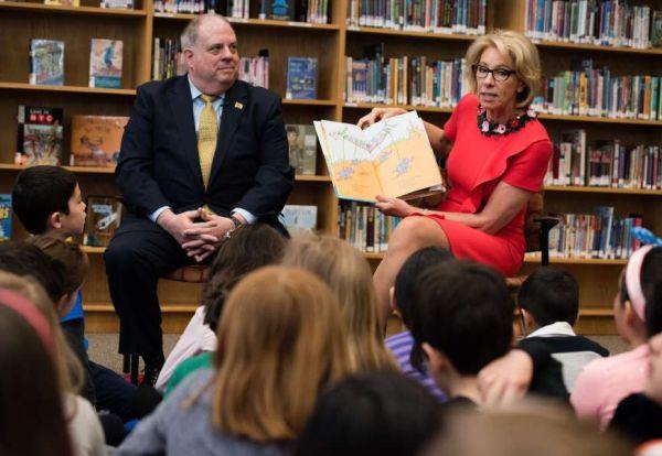 Trump administration Education Secretary Betsy DeVos, and Maryland Gov. Larry Hogan read to second-grade students at Carderock Springs Elementary School in Bethesda, Md. (Washington Post/Sarah L. Voisin)