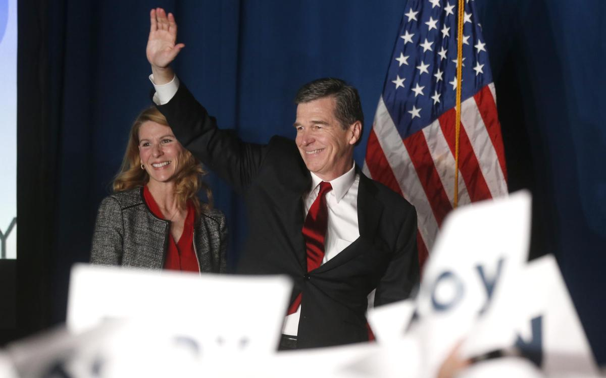 Roy Cooper waves to supporters on election night in Raleigh. News & Observer photo.