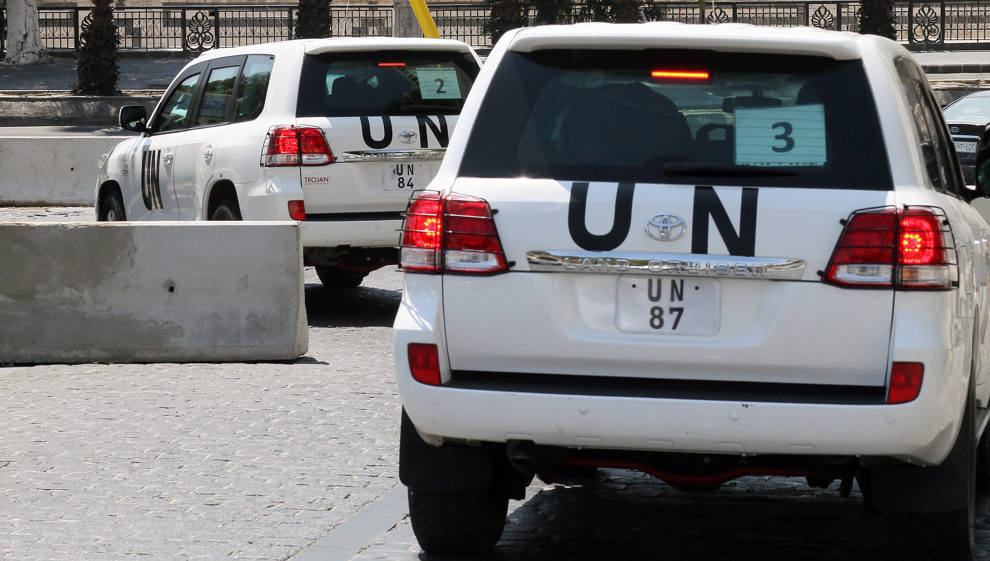 A United Nations inspectors team is seen leaving a hotel in Damascus, Syria, on Friday.