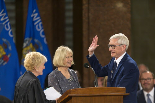 Wisconsin Gov. Tony Evers (right) is sworn in by Wisconsin Supreme Court Chief Justice Pat Roggensack as Kathy Evers watches during the inauguration ceremony at the state Capitol Jan. 7, 2019, in Madison, Wis. (Andy Manis / Associated Press)