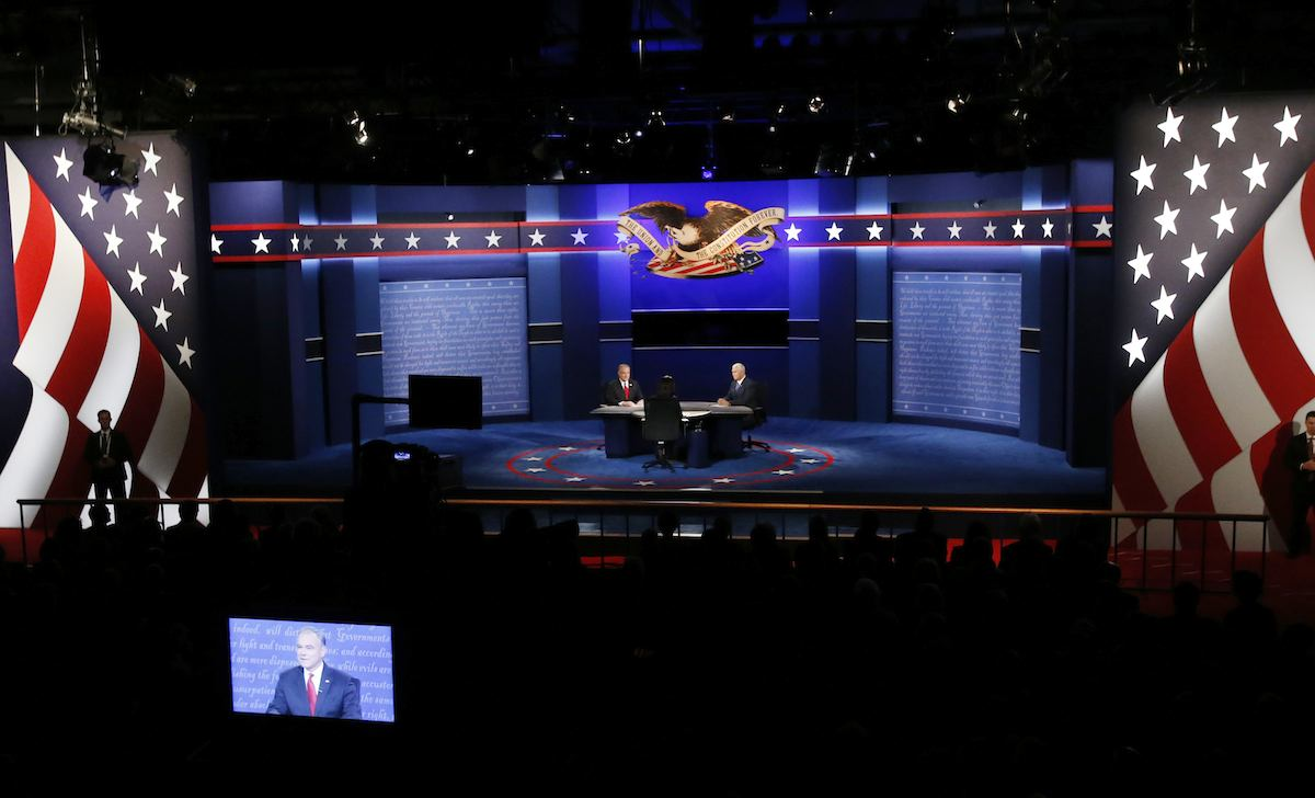 Republican vice-presidential nominee Gov. Mike Pence, right and Democratic vice-presidential nominee Sen. Tim Kaine debate during the vice-presidential debate at Longwood University in Farmville, Va., Tuesday, Oct. 4, 2016. (AP Photo/Steve Helber)