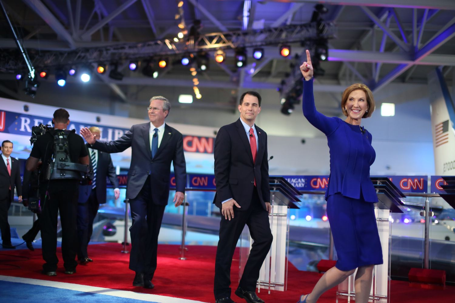 Republican presidential candidates Carly Fiorina, Wisconsin Gov. Scott Walker and Jeb Bush walk onstage at the Reagan Library on Sept. 16, 2015 in Simi Valley, Calif. (Getty Images)