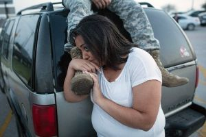 Lucy Hamlin and her husband, Spc. Timothy Hamlin, wait for permission to re-enter the Fort Hood military base, where they live, following a shooting on the base. (AP)