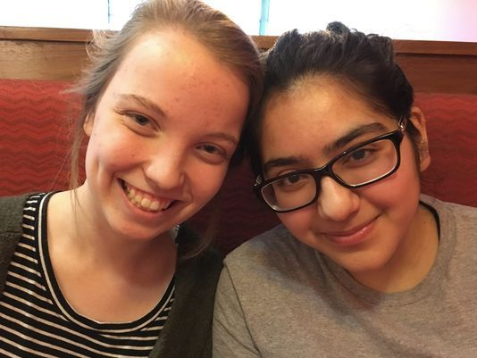 Friends Julia Craig (left) and Ravina Sachdev, high school juniors in suburban Milwaukee, agreed to disagree on a national march planned after the Florida school shooting. Sachdev participated, Craig didn't. (Annysa Johnson/Milwaukee Journal Sentinel)