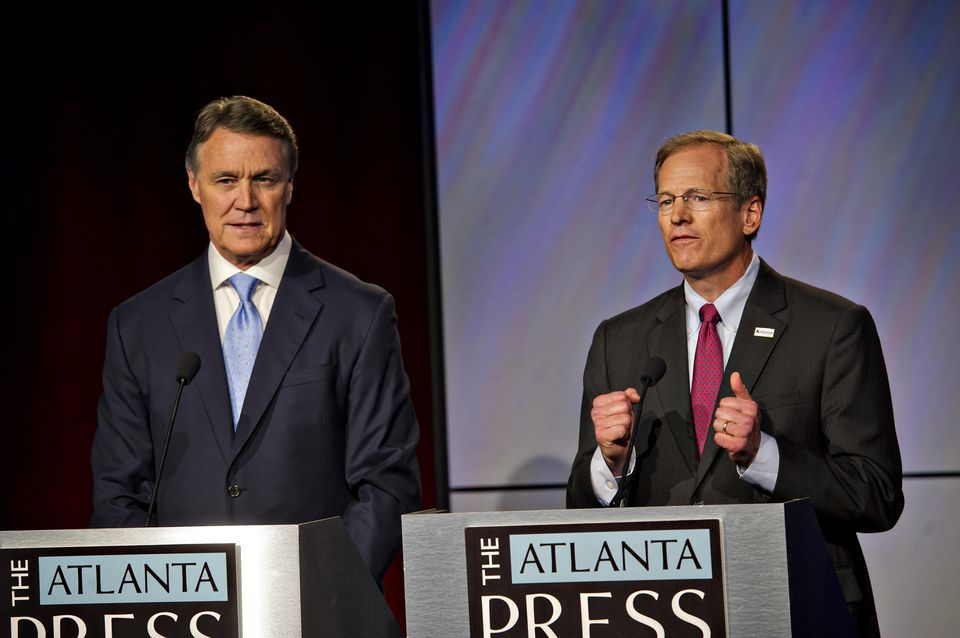 David Perdue, left, and Jack Kingston answer questions at a debate in Atlanta on July12, 2014. (Atlanta Journal-Constitution photo)