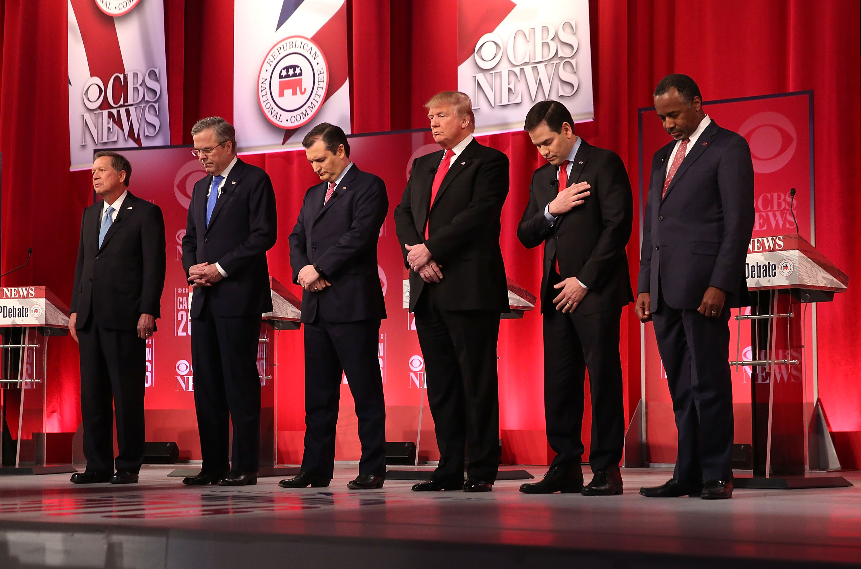 The Republican presidential candidates observe a moment of silence for Supreme Court Justice Antonin Scalia, who died the same day as the CBS debate on Feb. 13, 2016. (Getty)