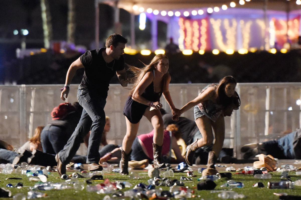 People run from the Route 91 Harvest country music festival after apparent gun fire was hear on Oct. 1, 2017, in Las Vegas, Nev. A gunman has opened fire on a music festival in Las Vegas, leaving at least 50 people dead and more than 400 injured. (Getty)