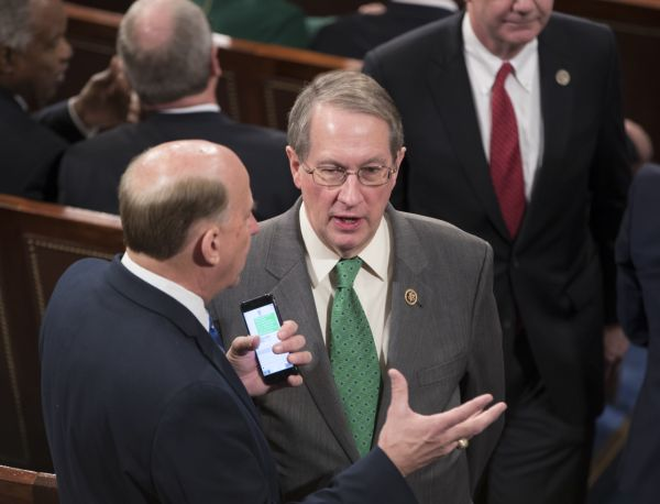 Rep. Bob Goodlatte, R-Va., talks with a colleague in the House Chamber on Jan. 3, 2017. The previous night, House Republicans approved Goodlatte's amendment to weaken the independent Office of Congressional Ethics. (AP/J. Scott Applewhite)