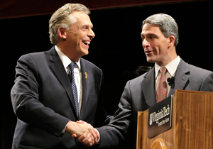 Democrat Terry McAuliffe, left, and Republican Ken Cuccinelli shake hands before their final debate in the Nov. 5 gubernatorial election. Photo by AP.