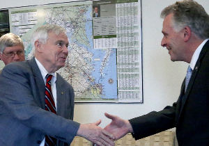 House Speaker Bill Howell, left, shakes hands with Gov. Terry McAuliffe before a recent meeting on the budget impasse. Behind Howell is Secretary of Finance Ric Brown.