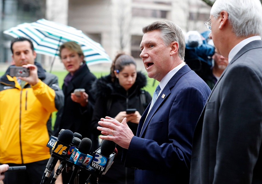 Republican Mark Harris, left, and his attorney David Freedman speak with the media after meeting with state election investigators at the Dobbs Building in Raleigh, N.C., Thursday, Jan. 3, 2019. (News & Observer)