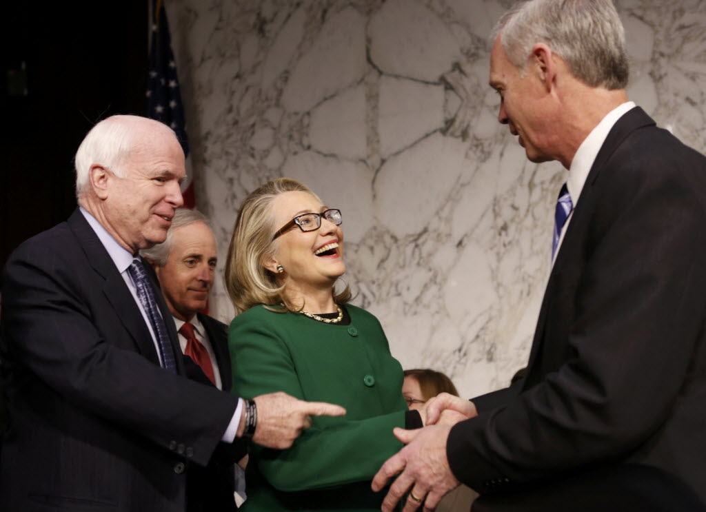 Then-Secretary of State and U.S. Sen. Ron Johnson, R-Wis., greeted each other prior to a Senate committee hearing on Jan. 23, 2013 in this Reuters photo.