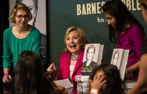 "Former Secretary of State Hillary Clinton signs her new book, ""Hard Choices,"" June 10, 2014, in New York City."