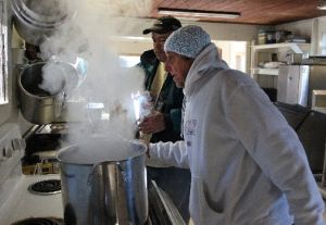 Art Helmrich, right, and Warren Hendrickson prepare a large pot of hot oatmeal for breakfast at the Holy Ground Homeless Shelter in Hudson, Fla. (Tampa Bay Times photo)