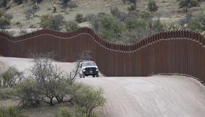 A border patrol agent monitors the international border in Arizona.