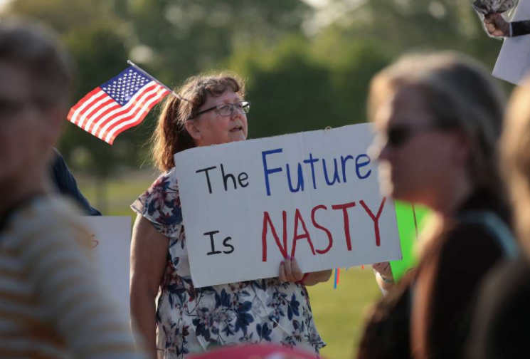 A protester outside a Cedar Rapids town hall meeting with Rep. Rod Blum, R-Iowa. (Getty)