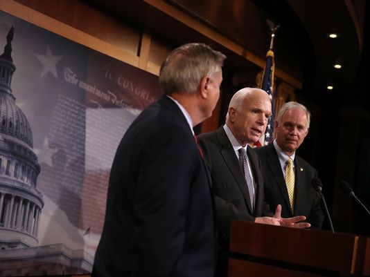 U.S. Sen. Ron Johnson (right) walked back comments he made about a fellow Republican, U.S. Sen. John McCain (center) and McCain's brain cancer. U.S. Sen. Lindsey Graham is also pictured. (Justin Sullivan/Getty Images)