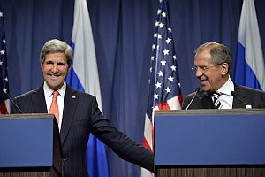 U.S. Secretary of State John Kerry, left, and Russian Foreign Minister Sergei Lavrov reach an agreement  in Geneva on Sept. 14, 2013 for Syria to destroy chemical weapons. (AP Photo)