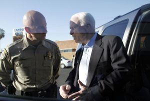 U.S. Sen. John McCain (R-AZ) speaks with Pinal County Sheriff Paul Babeu outside VFW Post #1677 during a campaign stop on April 24, 2010 in Casa Grande, Arizona.