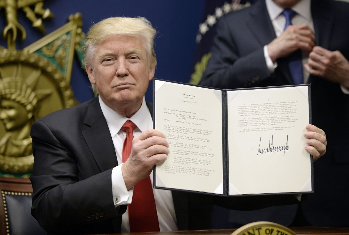 President Donald Trump signs Executive Orders in the Hall of Heroes at the Department of Defense Friday, Jan. 27, 2017 in Arlington, Va. (Olivier Douliery/Abaca Press/TNS)