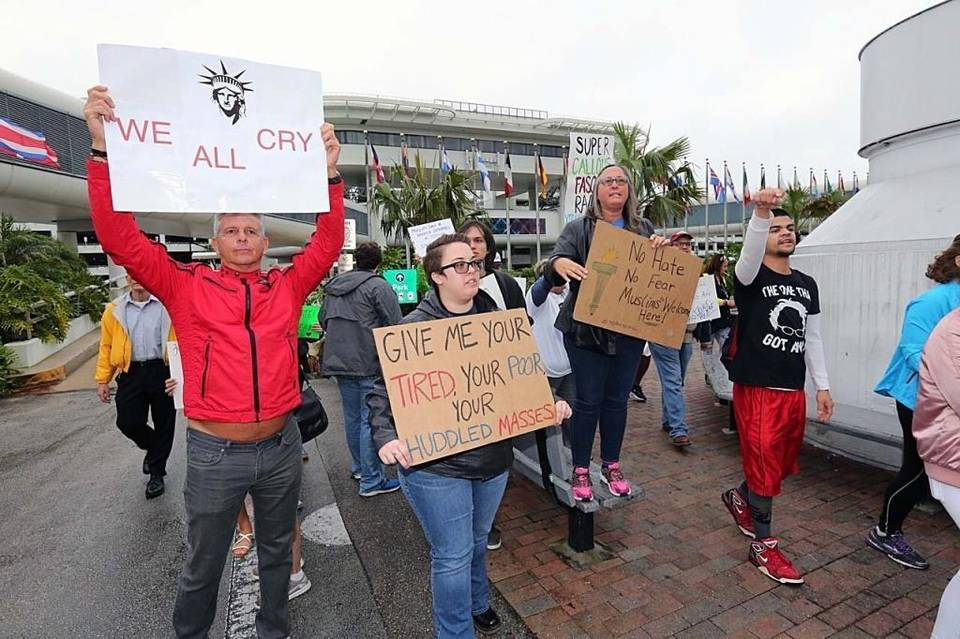 Protesters have their say against President Trump's executive orders on immigration during a rally at Miami International Airport on Sunday, January 29, 2017. (Miami Herald)