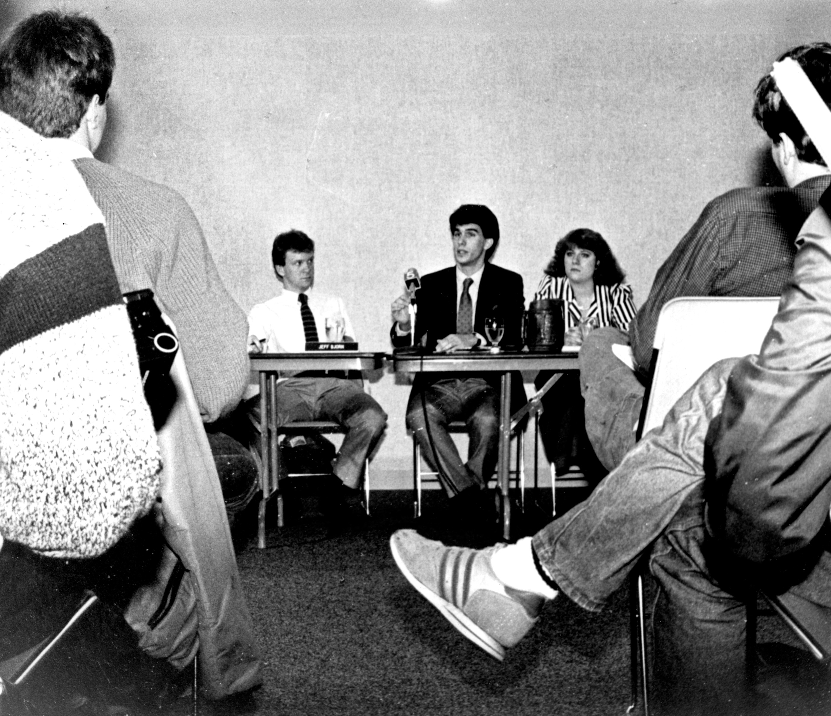 The 1987 Marquette yearbook shows student government officials Jeff Bjorn, Scott Walker and Kiki White announcing results of an impeachment probe of student leaders. Source: Dept. of Special Collections and University Archives, Marquette U. Libraries