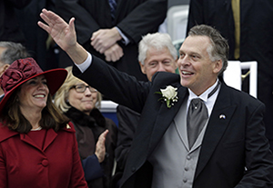 Gov. Terry McAuliffe, shown at his inauguration, with his wife, Dorothy. Behind them are former President Bill Clinton and former Secretary of State Hillary Clinton.