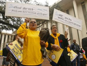 Protestors in Tallahassee, Fla., on March 3 urge the Florida Legislature to expand Medicaid. (AP Photo)