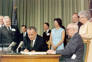 President Lyndon B. Johnson signed Medicare in 1965. Political attacks about Medicare started even before that.