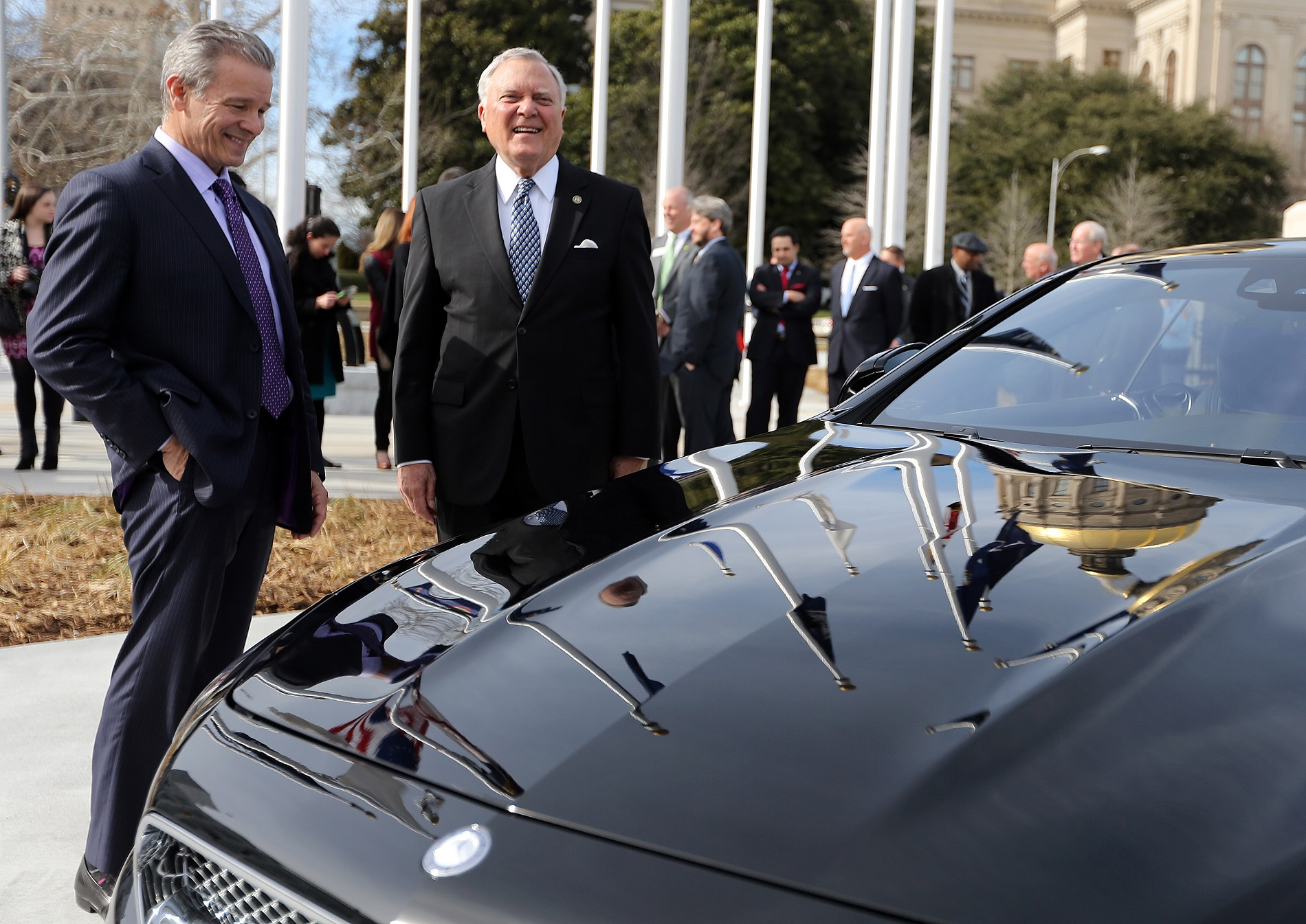 Mercedes-Benz USA CEO Steve Cannon and Gov. Nathan Deal look over a Mercedes at the State Capitol following the announcement the car maker is relocating its headquarters to Sandy Springs. BEN GRAY / AJC