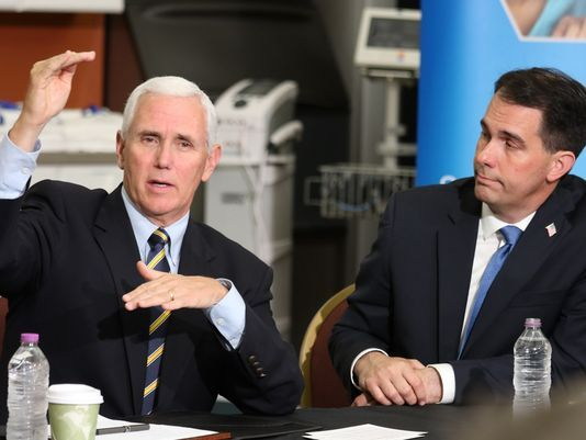 Vice President Mike Pence (left), who was joined by Wisconsin Gov. Scott Walker, appeared in Milwaukee on June 10, 2017. Pence bashed Obamacare and promised that Republicans would deliver a better replacement. (Pat A. Robinson/Milwaukee Journal Sentinel)
