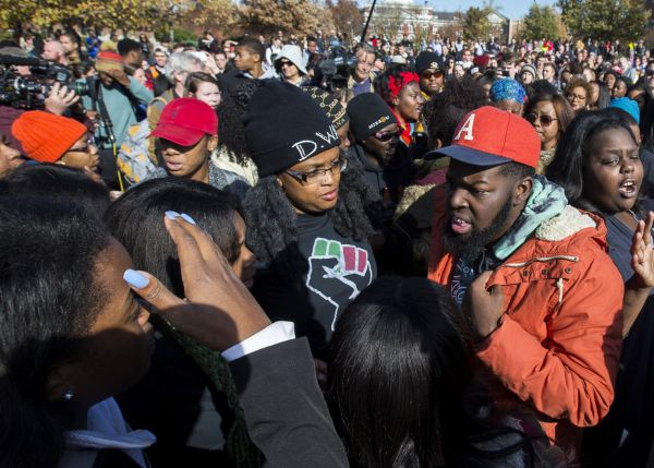Members of Concerned Student 1950 celebrate following the resignation of Missouri University president Timothy M. Wolfe on Nov. 9, 2015. (Brian Davidson/Getty Images)