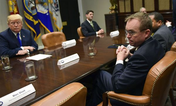 White House budget director Mick Mulvaney, right, attends a meeting with President Donald Trump, left, in the Roosevelt Room of the White House on Nov. 28, 2017. (AP/Susan Walsh)