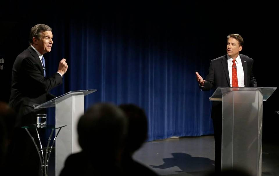 North Carolina Gov. Pat McCrory, right, faced off with challenger Attorney General Roy Cooper, left, in a debate on Tuesday, Oct. 11. Associated Press photo.