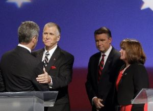 North Carolina GOP senatorial candidates Greg Brannon, left, and Thom Tillis shake hands as Mark Harris and Heather Grant, right, look on at a debate on April 28, 2014.