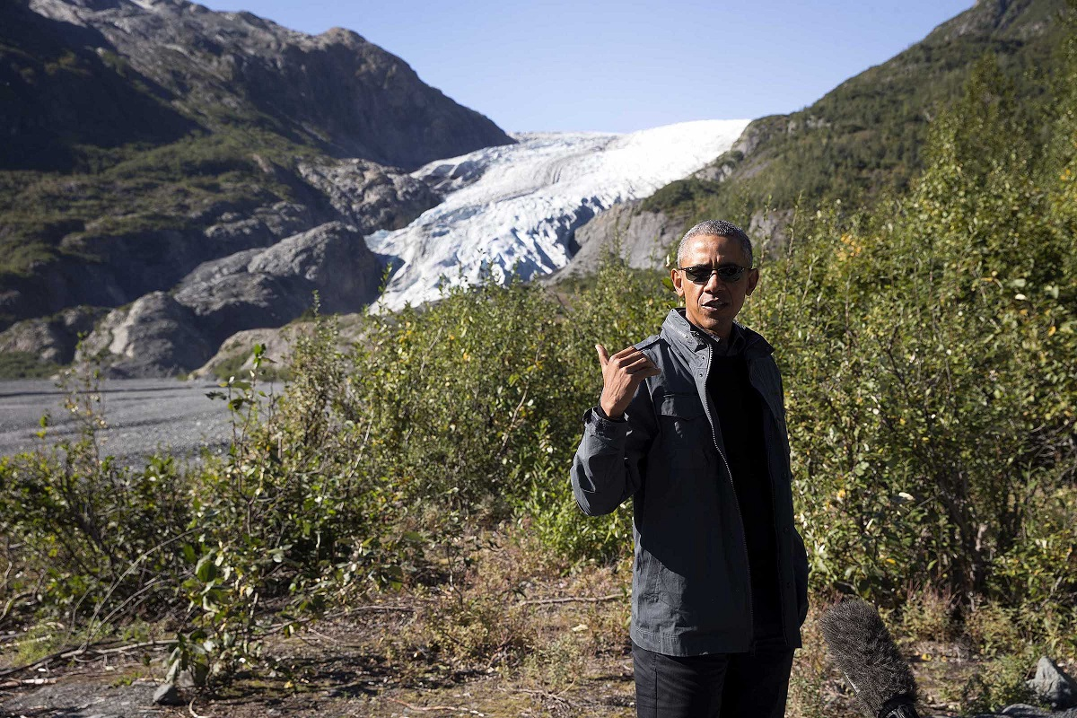President Barack Obama speaks to reporters during a hike at Exit Glacier in Alaska, Sept. 1, 2015. (The New York Times)