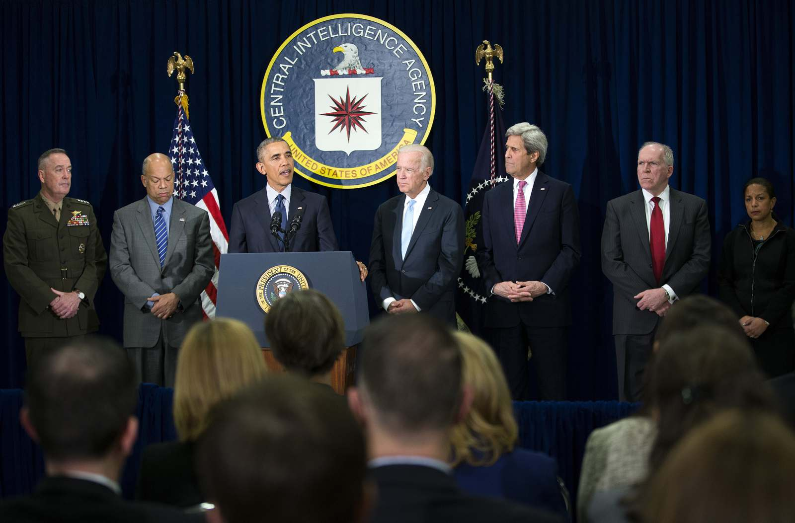 President Barack Obama, with a group of national security officials, speaks following a meeting at CIA headquarters in Langley, Va., April 13. (New York Times)