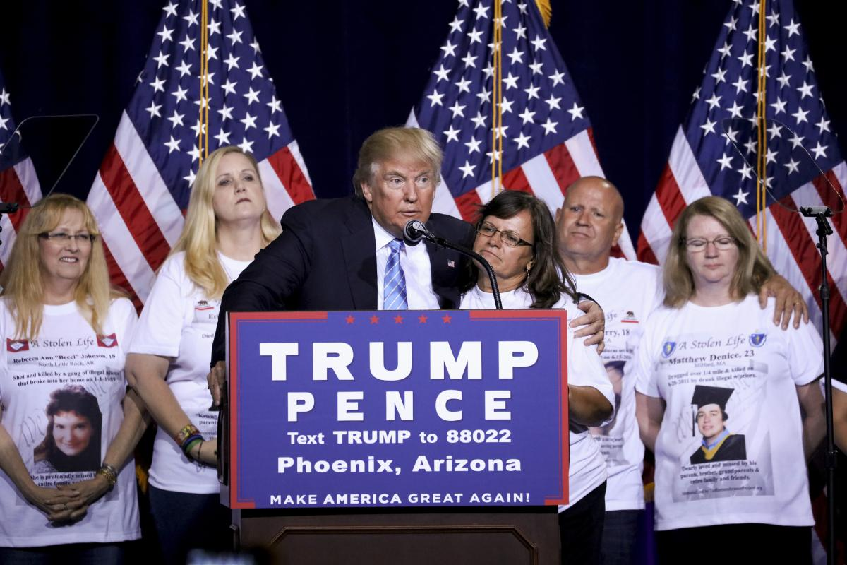 """Donald Trump, the Republican presidential nominee, with """"Angel Moms,"""" parents who say their children were killed by illegal immigrants, during a campaign event focused on immigration policy in Phoenix, Aug. 31, 2016. (New York Times)"""