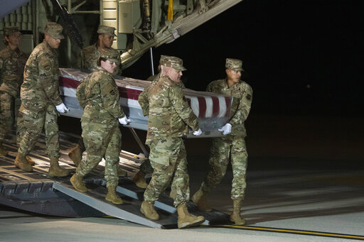 An Air Force carry team moves the transfer case containing the remains of Navy Seaman Apprentice Cameron Scott Walters, of Richmond Hill, Ga., Dec. 8, 2019, at Dover Air Force Base.  A Saudi gunman killed three people at the Naval base in Pensacola. (AP)