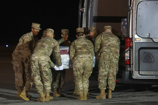 An Air Force carry team moves a transfer case containing the remains of Navy Seaman Mohammed Sameh Haitham, of St. Petersburg, Fla., Dec. 8, 2019, at Dover Air Force Base, Del. A Saudi gunman killed three people including Haitham in a shooting. (AP)