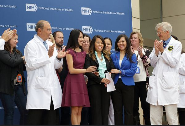 Ebola patient Nina Pham (center) with her family and supporters after a press briefing on her release from the National Institutes of Health in Bethesda, Md., on Oct. 24, 2014. (NIH photo)