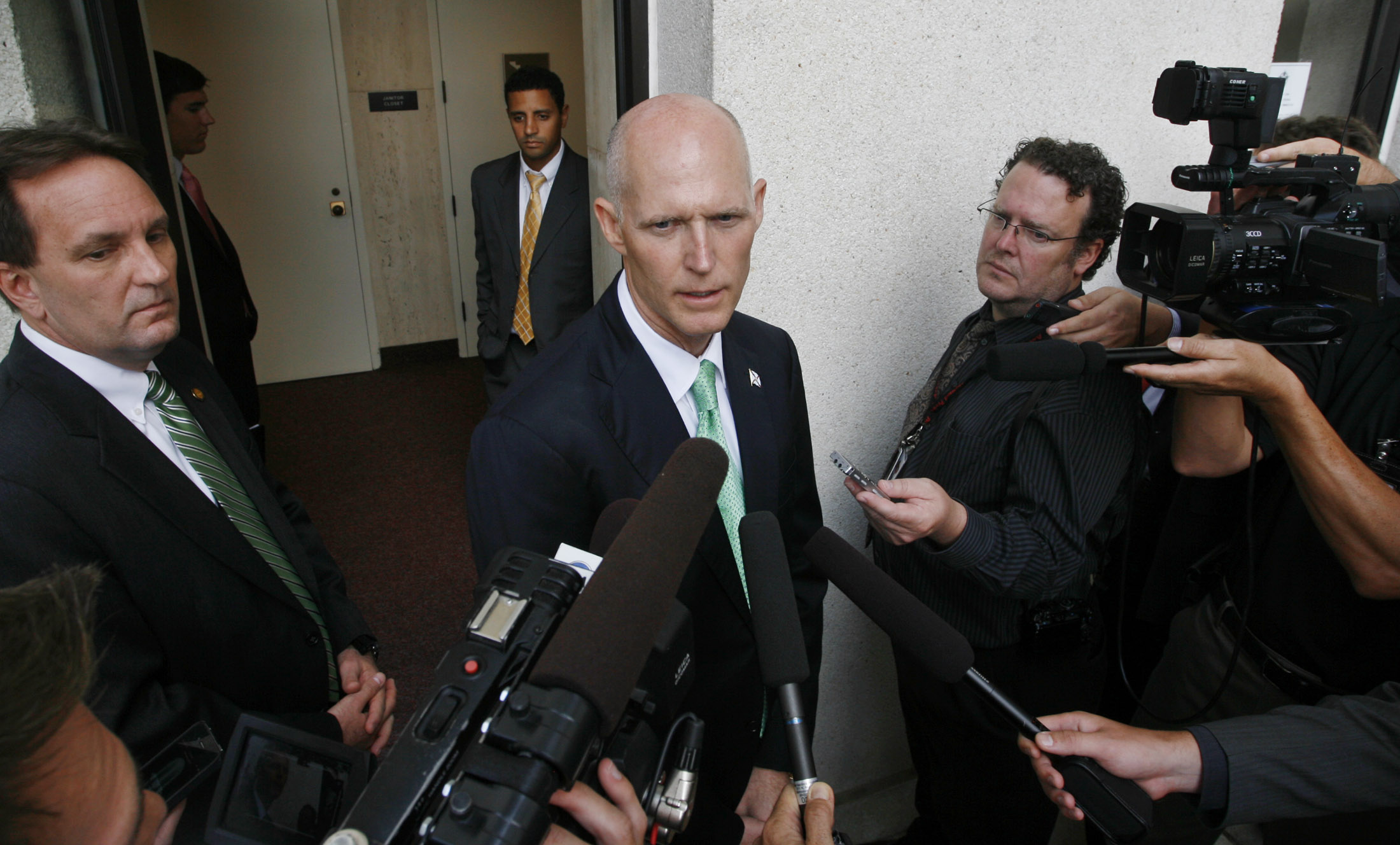 Rick Scott speaks with reporters during the final week of his first legislative session.