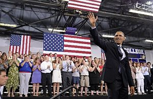 President Barack Obama waves after giving a speech on the economy at Knox College  in Galesburg, Ill. (AP Photo)