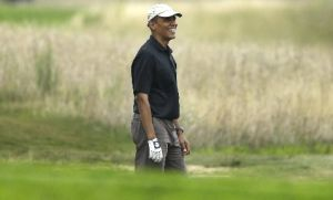 President Barack Obama golfs at the Vineyard Golf Club in Edgartown, Mass., Aug. 12, 2013.