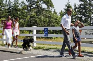 President Barack Obama, first lady Michelle Obama, daughters Malia and Sasha, and dog Bo in Bar Harbor, Maine, on July 17, 2010.